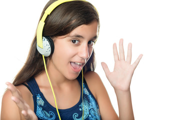 Hispanic teenage girl  listening to music