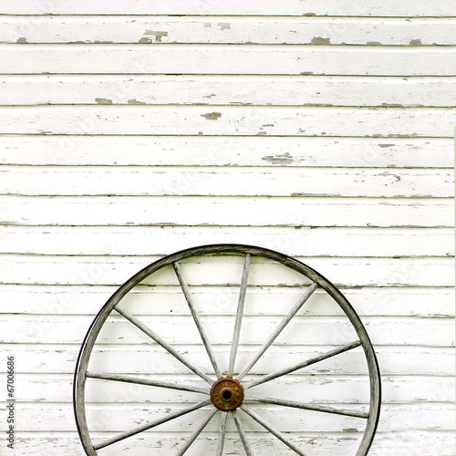 Antique Wooden Wagon Wheel on Rustic White Background - 67006686