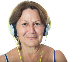 Senior hispanic woman listening to music on her headphones