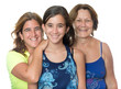 Hispanic girl with her mother and grandmother hugging