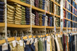 Neat stacks of folded clothing on the shop shelves - 67008067