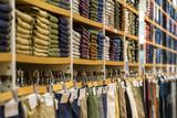 Neat stacks of folded clothing on the shop shelves - 67008067