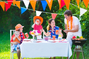Adorable dutch family having grill party