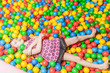 Young child playing in ball pool