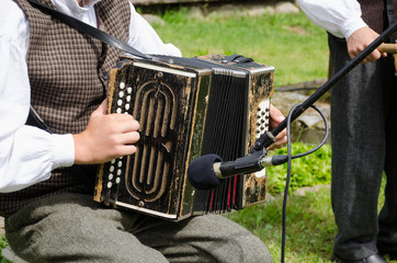 Accordionist man play folk music with accordion