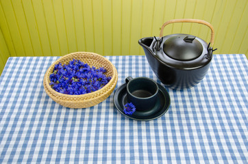 healing fresh aromatic cornflower tea set on table