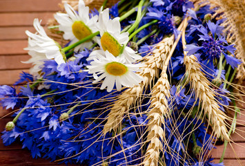 Bouquet of daisies, cornflowers and spikelets