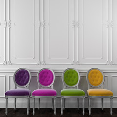 Fancy colorful chairs against a white wall