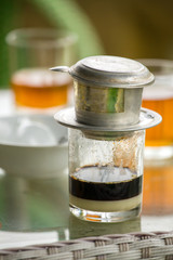 Glass of strong vietnamese filter dripping coffee