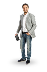 Cool businessman with tablet PC in his hand