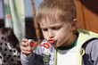 Kid blowing soap bubble