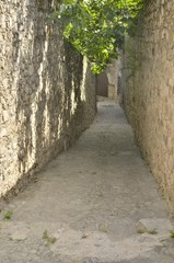 Narrow stone alley in Trujillo, Spain