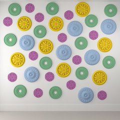 Beautiful colored rosettes on a white wall