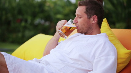 Man drinking beer in exotic place