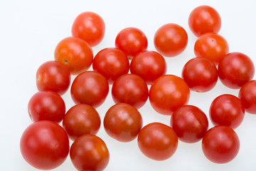 Fresh ripe cherry tomatoes isolated on a white background