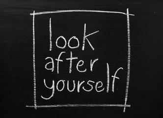 Look After Yourself written on a used blackboard