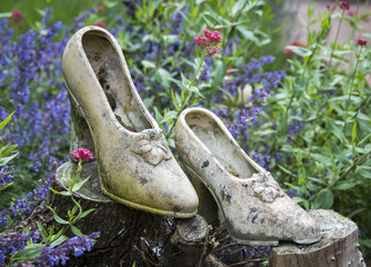 concrete woman shoes in garden