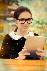 Young Woman with Glasses and Tablet