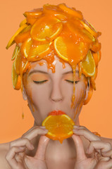 Portrait woman in cap of oranges