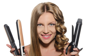 Woman holds curling iron