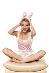 lovely blonde girl in rabbit costume have a fun