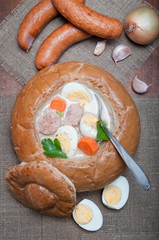 Easter white borscht with eggs and sausage in a bread bowl