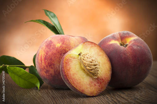 canvas print picture Fresh peach sliced close up on the table