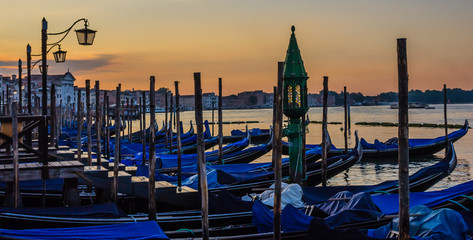 Panoramic view of gondolas at sunrise in Venice, Italy
