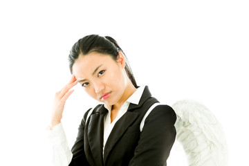 Asian young businesswoman dressed up as white angel suffering