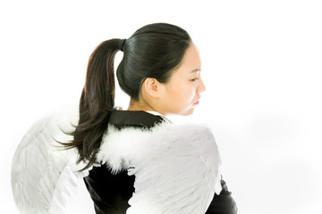 Rear view of angel side of a young Asian businesswoman thinking