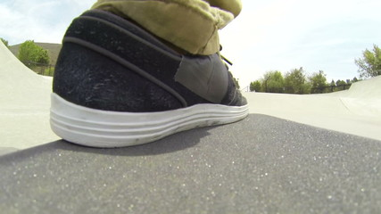 POV Foot on Skateboard at Skatepark