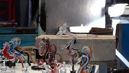 Craftsman makes the glass flower in the glass blower workshop