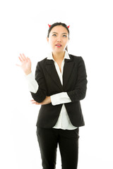 Devil side of a young Asian businesswoman gesturing and ignoring
