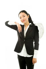 Asian young businesswoman dressed up as an angel pretending to