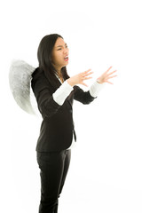Asian young businesswoman dressed up as an angel strangling