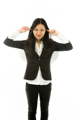 Irritated Asian young businesswoman dressed up as an angel
