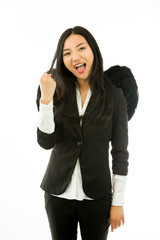 Excited Asian young businesswoman dressed up as a black angel