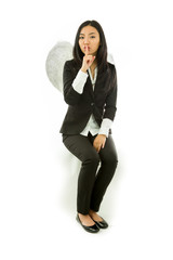 Asian young businesswoman sitting on stool dressed up as an