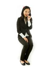 Asian young businesswoman sitting on stool in devil horns thumbs