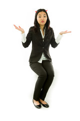 Asian young businesswoman sitting on stool in devil horns don't