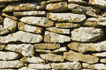 Dry stone limestone wall, small stones, texture, pattern backgro