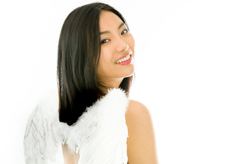 Angel side of a young Asian woman turning back and smiling
