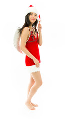 Asian young woman wearing Santa costume dressed up as an angel