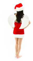 Rear view of a Asian young woman wearing Santa costume dressed