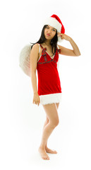 Disappointed Asian young woman wearing Santa costume dressed up