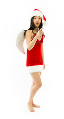 Shocked Asian young woman wearing Santa costume dressed up as an