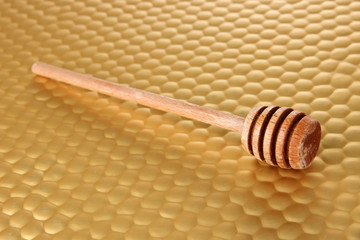 Honey comb on bright yellow background