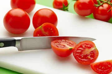 fresh tomato on cutting board