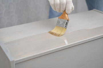 Varnishing the wooden chest