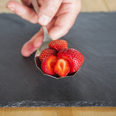 Red, ripe strawberries on a spoon close up - dose of vitamin C!
